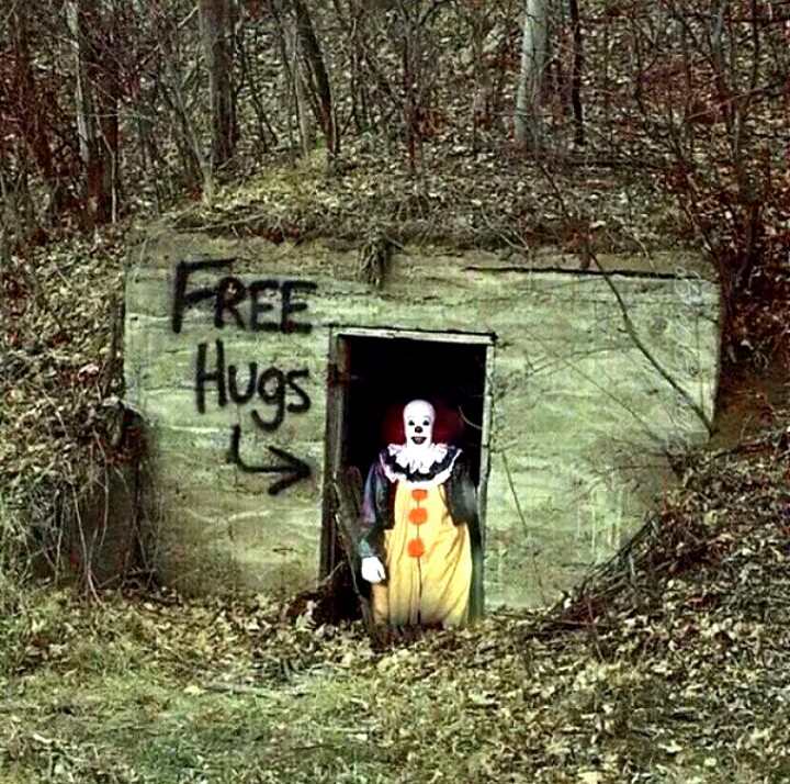 Clown in the woods offering free hugs