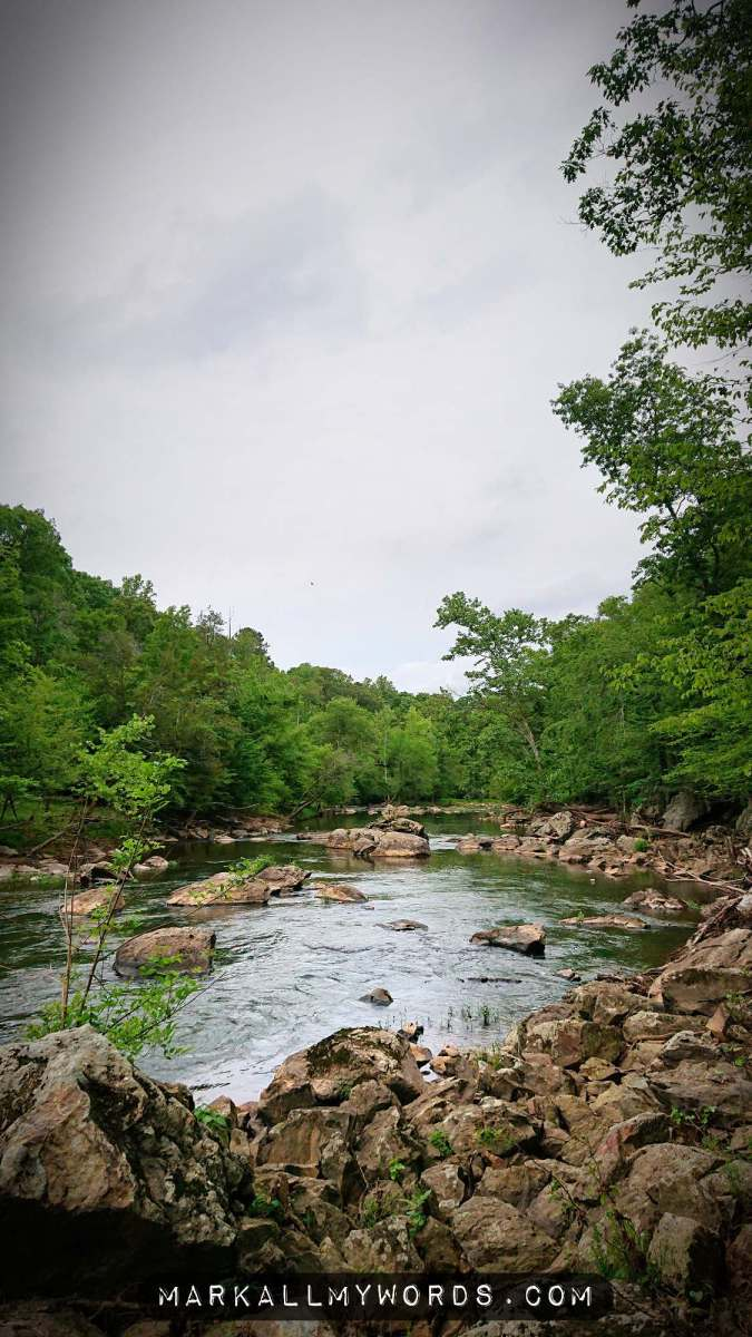Eno River with boulders, winding into distance