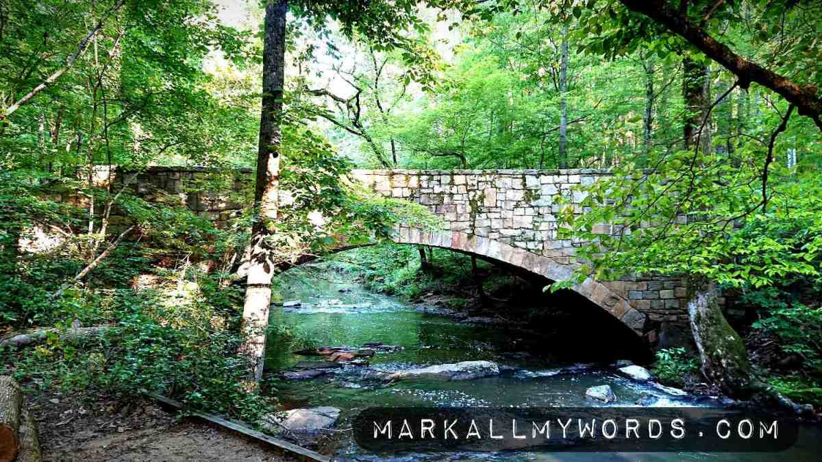 Stone bridge over Sycamore Creek in forest