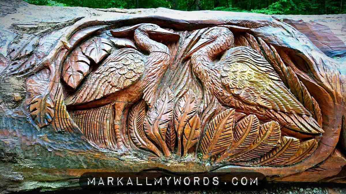 Pair of egrets carved into tree sculpture
