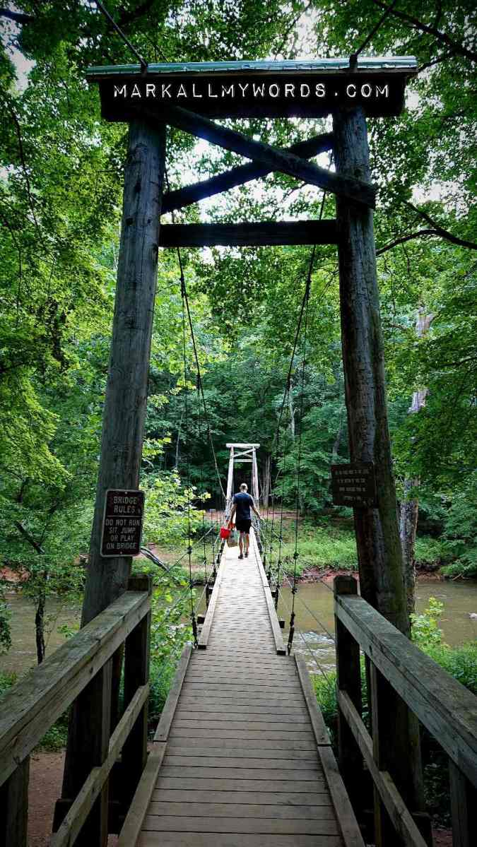 Wooden suspension footbridge over Eno River