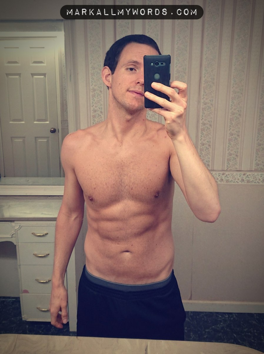 Shirtless white guy in mirror selfie
