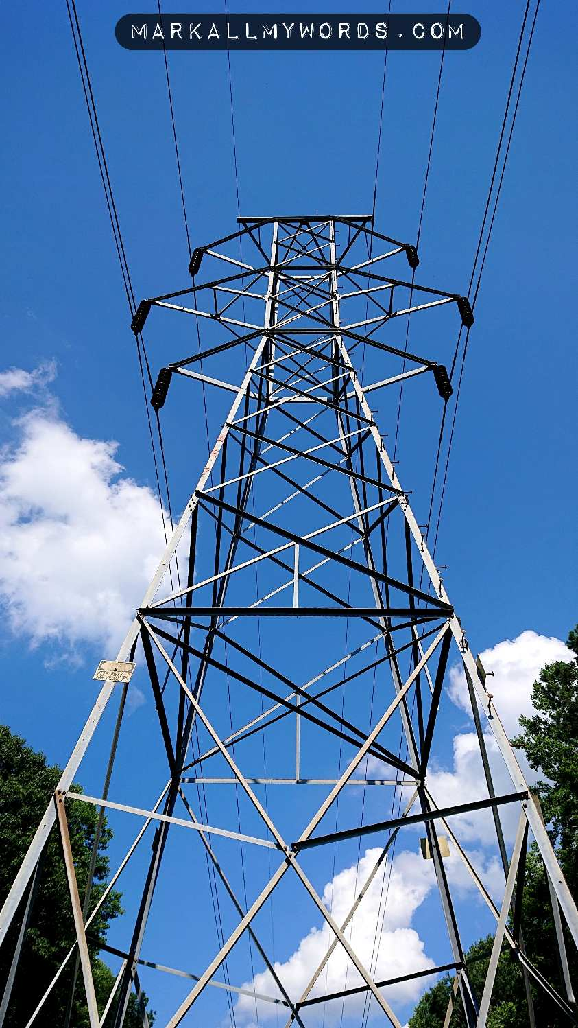 Closeup of power line with blue sky overhead