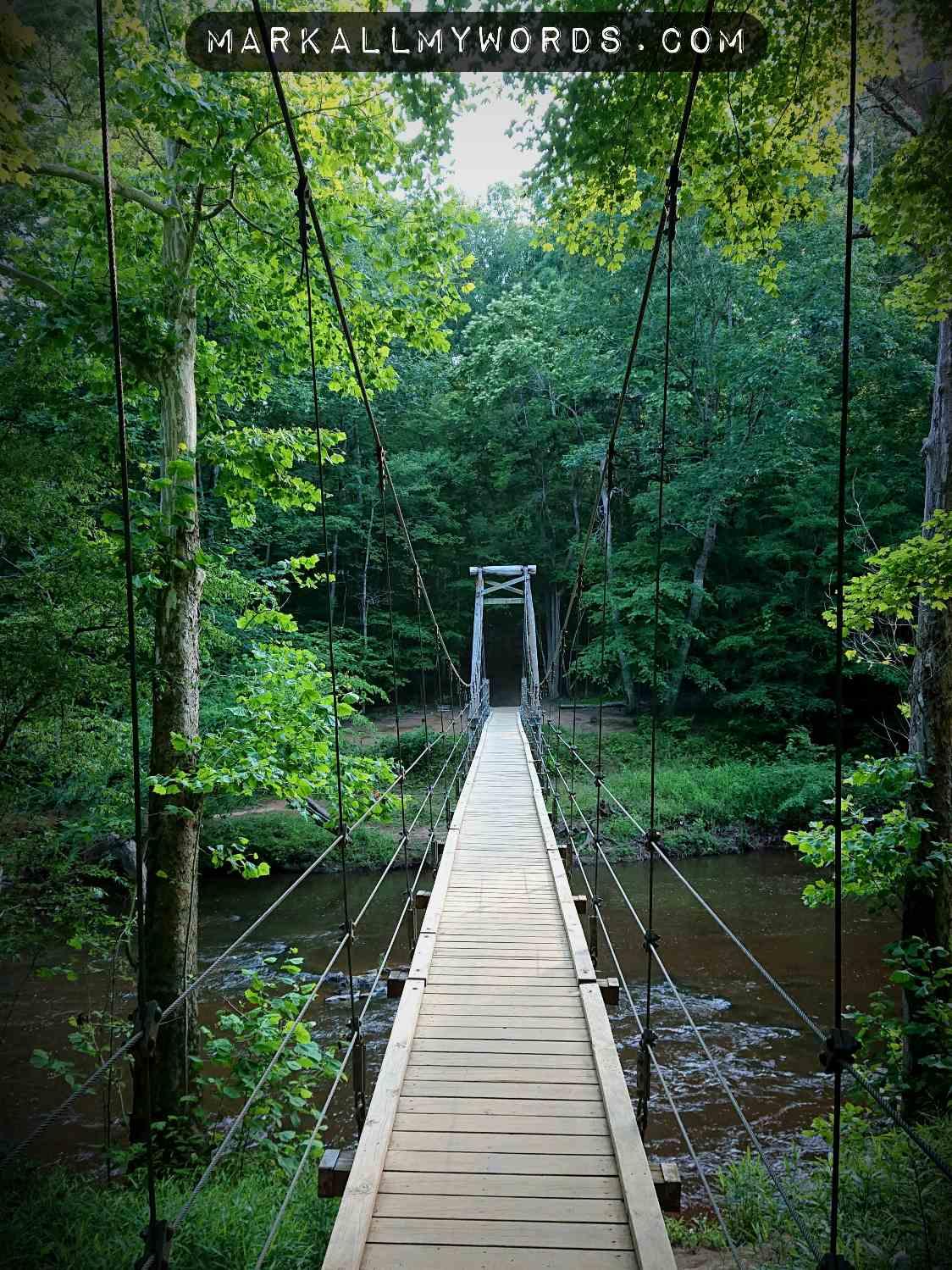 Wooden suspension footbridge over Eno River