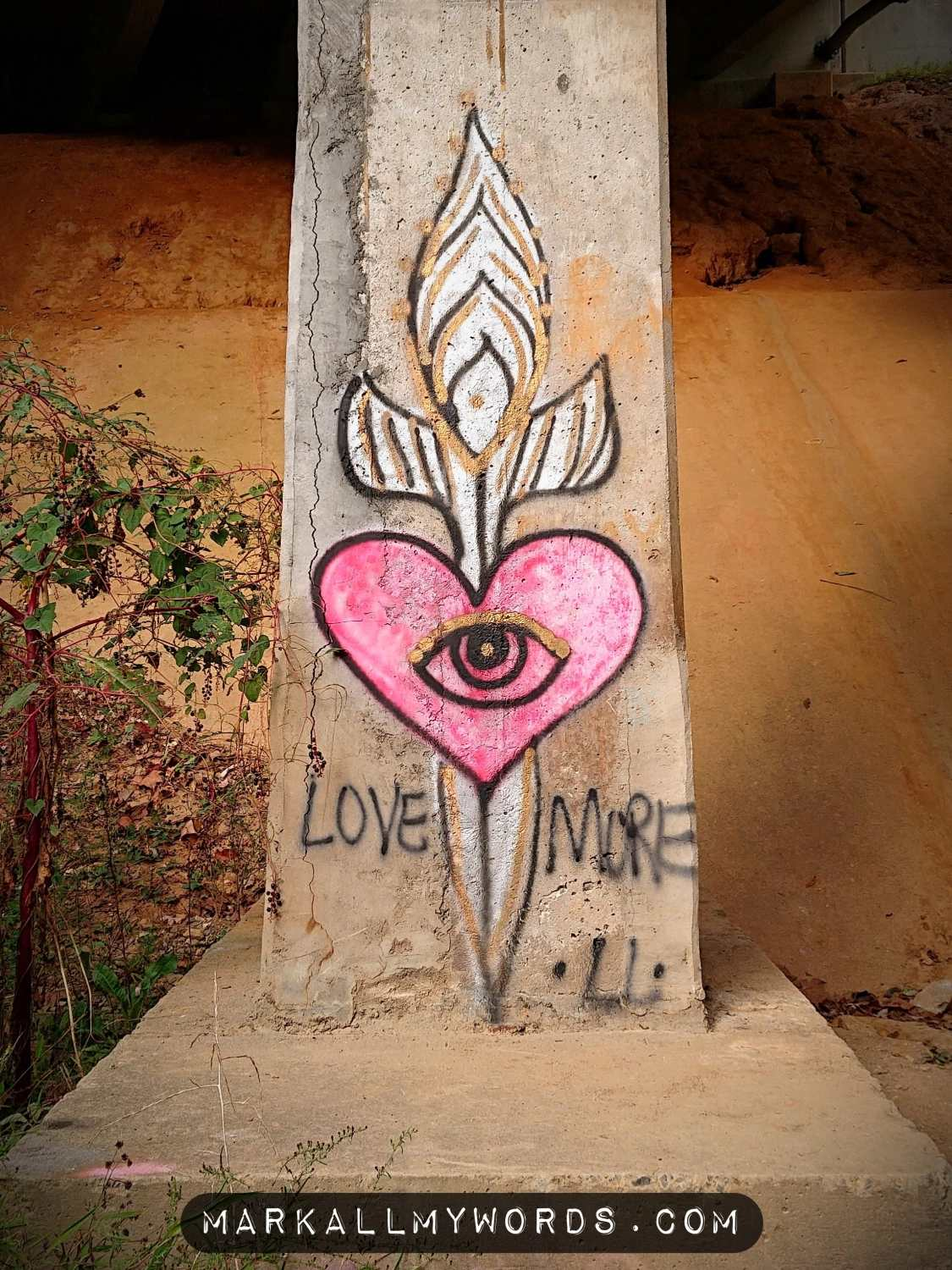 Surreal street art with pink heart and eye