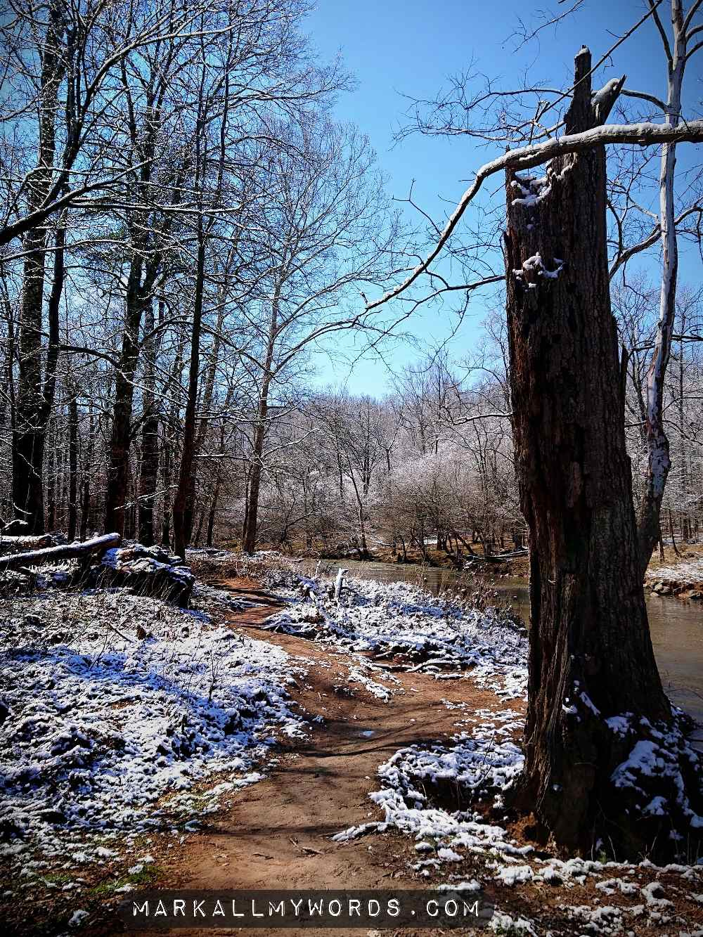 Snowy trail by river