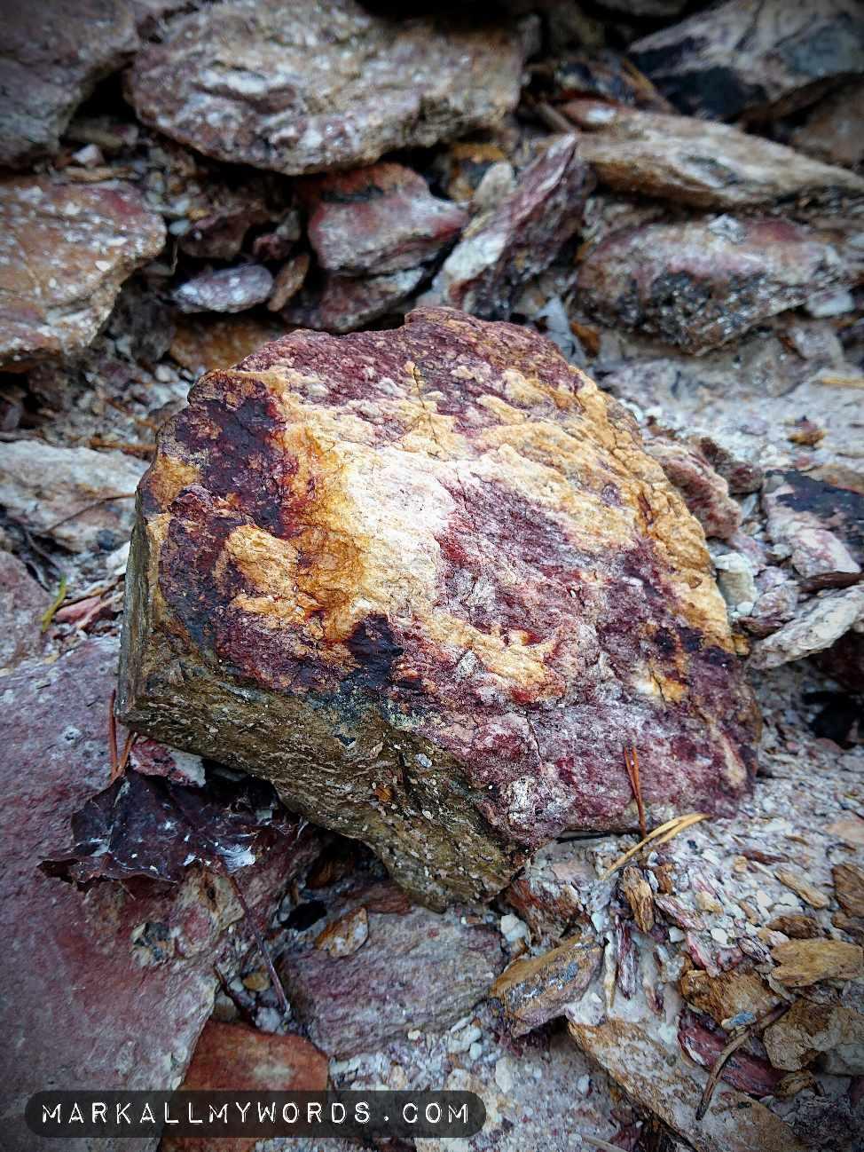 Quartz with ring of reddish iron oxide