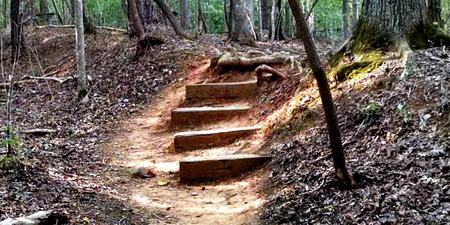 Trail with red dirt and steps